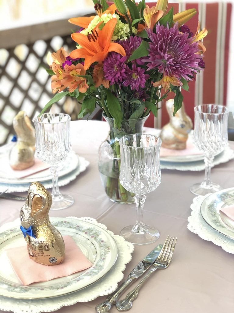 Pink and lace themed Easter table setting.