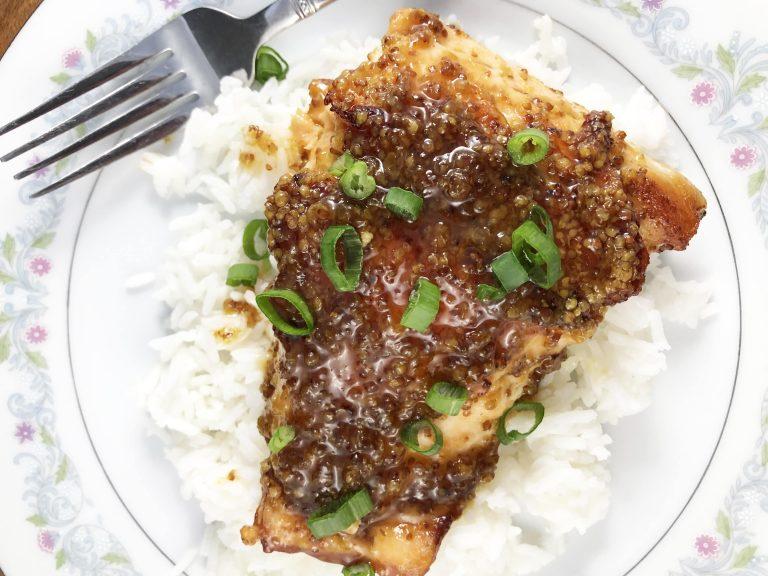 Maple Dijon Glazed Salmon served over rice.